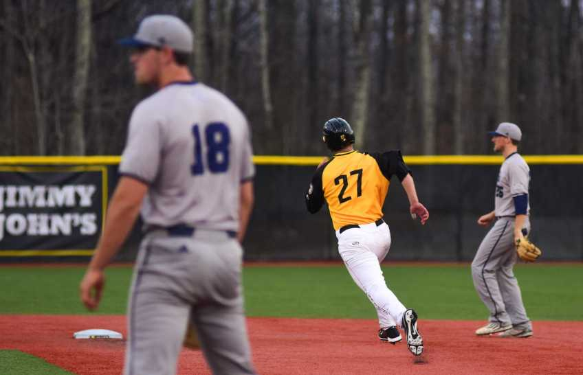 Senior infielder Grayson Atwood runs to second base. Photo by Dallas Linger, Photo Editor.