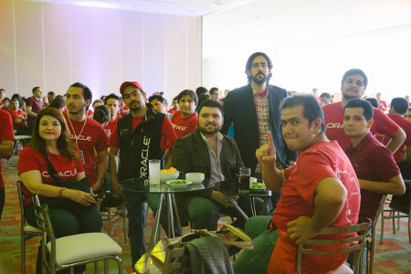 Members of different teams (UX, UAE) hang out at the celebration.