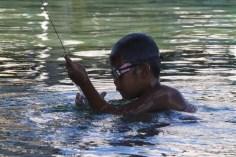 Bajau boy with speargun, Sanpela, Wakatobi, Indonesia