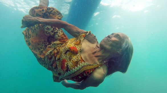Lola Maria dives for coins 74 years old