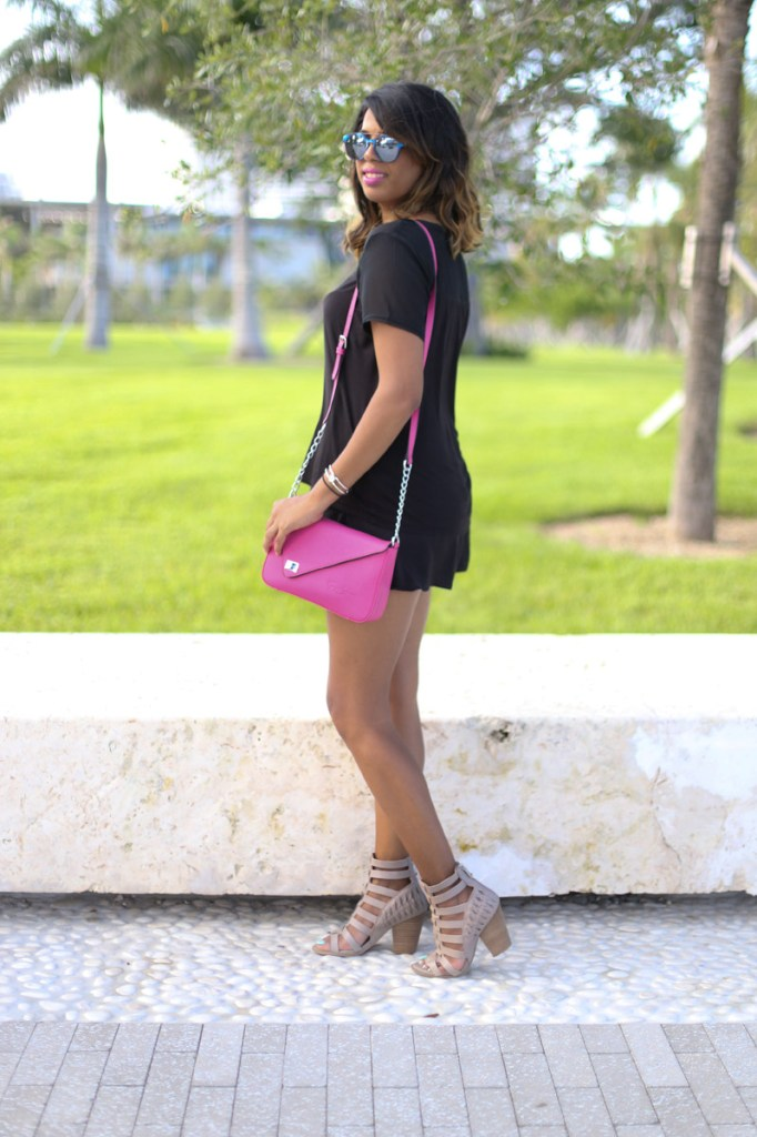 Dressed all black with a pop of color