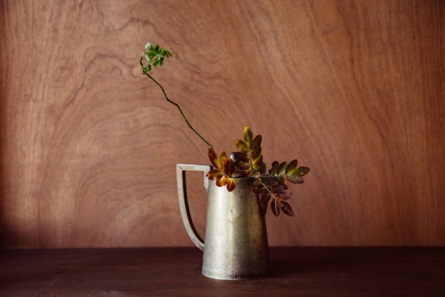 moody winter still-life with snowberry in vintage vase