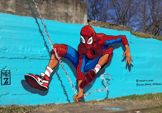 Street Art mural of Miles Morales dressed in a Spiderman costume. Miles Morales is the main character from the animated movie Spiderman: Into the Spider-verse.