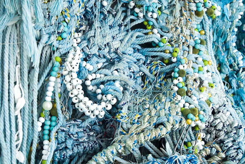 """Igshaan Adams, """"Look Again, Look Closer! (detail)"""", 2018. Rope, beads, twine, wire, blue oxide, dye. 140 x 67 cm. Courtesy Blank Projects."""