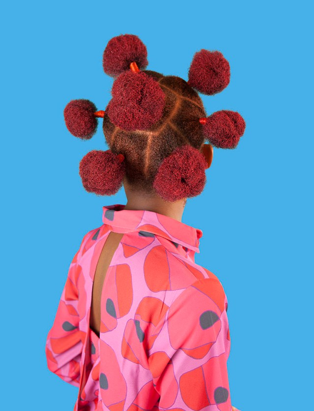 "Medina Dugger, ""Pink Buns"", from series ""Chroma An ode to J.D. 'Okhai Ojeikere"", 2017. Fiber Pigment Print on Dibond. Edition sizes 45.7 x 60.6 cm and 91.45 x 121.2 cm. Copyright: Medina Dugger. Courtesy Art Twenty One. Hair designs by Ijeoma Christopher."