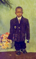 "Karl Ohiri, ""Blazer boy with phone (Circa 1990's); Courtesy of Lagos Studio Archives"