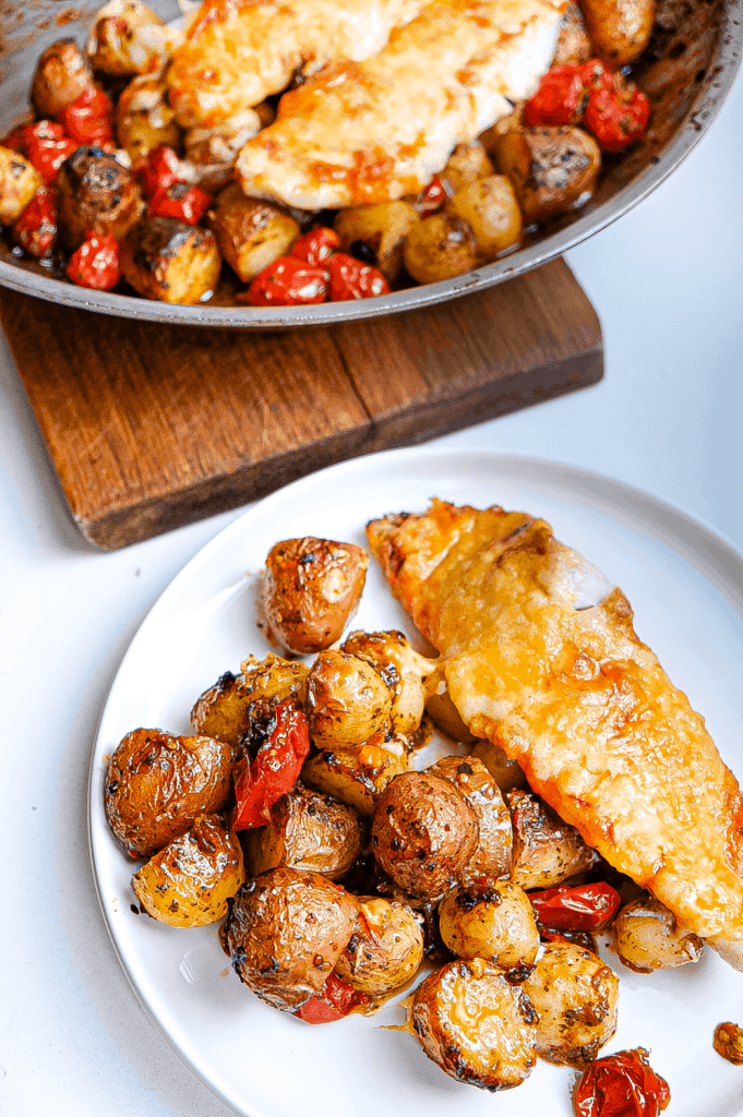 Saffron red fish with herb & red pepper potatoes.