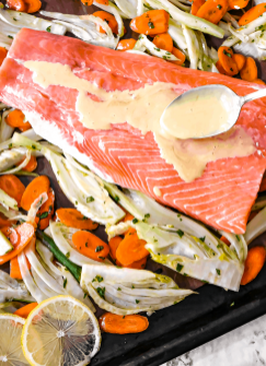 Easy sheet pan roasted salmon, fennel and carrot with yogurt dill sauce.