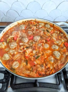 The meatballs simmer in the soup until the rice is cooked.