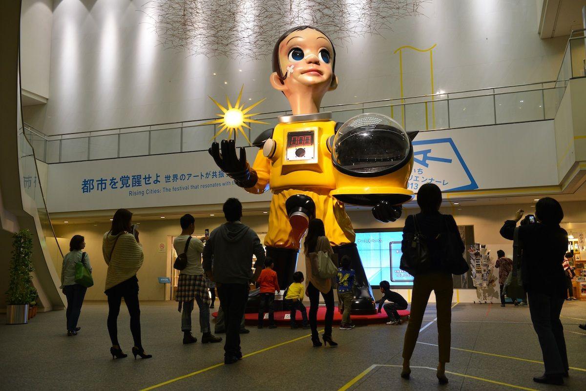 Installation view of the 2013 edition of the Aichi Triennale featuring Sun Child No. 2 by Kenji Yanobe. Photo courtesy Aichi Triennale.