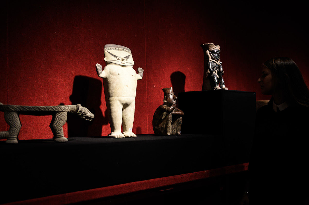 Pre-Columbian artifacts on display at Drouot auction house in Paris ahead of a sale. Photo by Philippe Lopez/AFP/Getty Images.