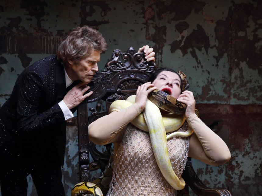 Ms. Abramovic, right, and Willem Defoe in one of the films that accompany the opera's seven arias.Credit...Marco Anelli