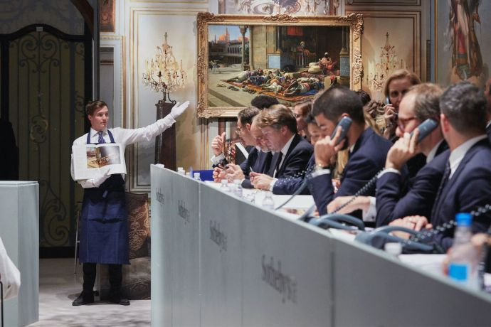 Sotheby's specialists on phones with clients during an auction. Photo courtesy Sotheby's..jpeg