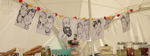 Caricatures hung up at a wedding