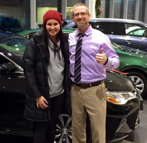 Morgan and John in front of her new 2015 Toyota Camry LE