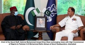 NAVAL CHIEF AMJAD KHAN NIAZI EXCHANGING VIEWS COMMISSIONER OF NIGERIA