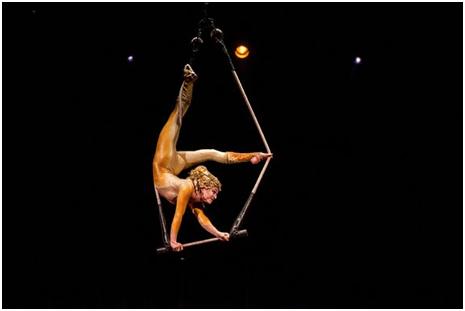 A trapeze artist in Varekai (Photo credit: Courtesy of Cirque de Soleil)
