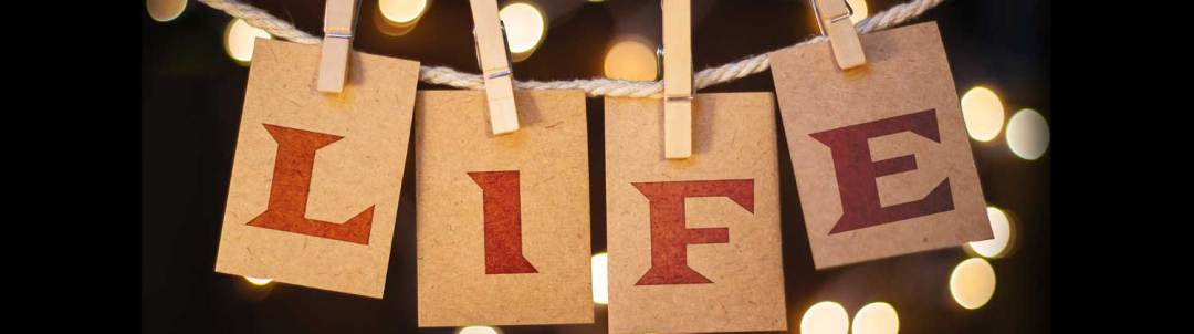 Image of cards spelling LIFE on a clothesline with wooden clothespin