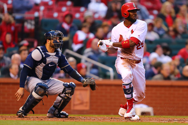 St. Louis Cardinals outfielder Dexter Fowler hits an RBI single against the Milwaukee Brewers in an April 2018 game