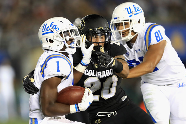 UCLA tight end Caleb Wilson lays a block for his running back during a September 2017 game against Colorado.