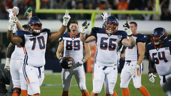 The Orlando Apollos celebrate scoring a touchdown against the Atlanta Legends