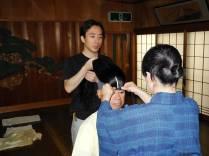 Oshima Teruhisa & Oshima Kinue affixing the wig to Terada Ryoji. ©2013 Megan Nicely.