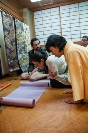 Examining cloth. L-R: Gwen van den Eijnde, Yayoi Shinoda, Yumiko Okada, Aragorn Quinn