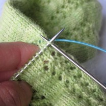 ... and start knitting **with your normal size needles**. The first few stitches may feel awkward because of the cut end still attached, but this is normal.