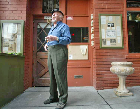 Specs Simmons in front of his Pub