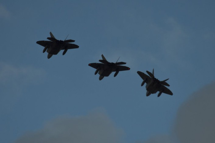Three F-22 Raptor fighter aircraft assigned to the 95th Fighter Squadron at Tyndall Air Force Base, Fla., fly over the runway before landing at Spangdahlem Air Base, Germany, Aug. 28, 2015. The U.S. Air Force deployed four F-22s, one C-17 Globemaster III and more than 50 Airmen to Spangdahlem in support of the first F-22 European training deployment. The inaugural F-22 training deployment to Europe is funded by the European Reassurance Initiative, a $1 billion pledge announced by President Obama in March 2014. (U.S. Air Force photo by Airman 1st Class Luke Kitterman/Released)