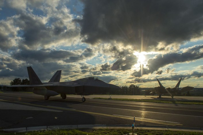 Two F-22 Raptor fighter aircraft assigned to the 95th Fighter Squadron at Tyndall Air Force Base, Fla., taxi to hardened aircraft shelters at Spangdahlem Air Base, Germany, Aug. 28, 2015. The U.S. Air Force deployed four F-22s, one C-17 Globemaster III and more than 50 Airmen to Spangdahlem in support of the first F-22 European training deployment. The inaugural F-22 training deployment to Europe is funded by the European Reassurance Initiative, a $1 billion pledge announced by President Obama in March 2014. (U.S. Air Force photo by Airman 1st Class Luke Kitterman/Released)