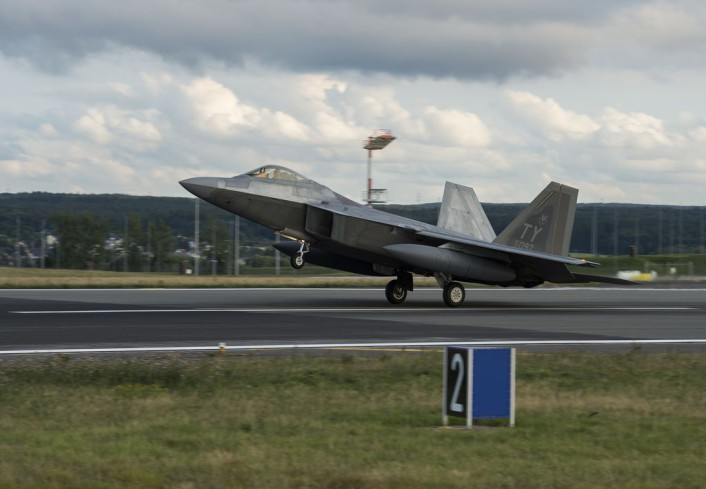 An F-22 Raptor fighter aircraft lands at Spangdahlem Air Base, Germany, Aug. 28, 2015, as part of the inaugural F-22 training deployment to Europe. The F-22s are deployed from the 95th Fighter Squadron at Tyndall Air Force Base, Fla., as part of the European Reassurance Initiative and will conduct air training with other Europe-based aircraft while demonstrating U.S. commitment to NATO allies and the security of Europe. (U.S. Air Force photo by Staff Sgt. Chad Warren/Released)