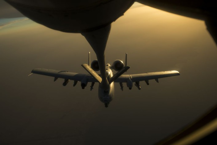 A U.S. Air Force A-10 Warthog, assigned to the 163rd Expeditionary Fighter Squadron, receives fuel from a KC-135 Stratotanker, 340th Expeditionary Aerial Refueling Squadron, over Southwest Asia, Oct. 13, 2015. Coalition forces fly daily missions in support of Operation Inherent Resolve. (U.S. Air Force photo by Senior Airman Taylor Queen/Released)