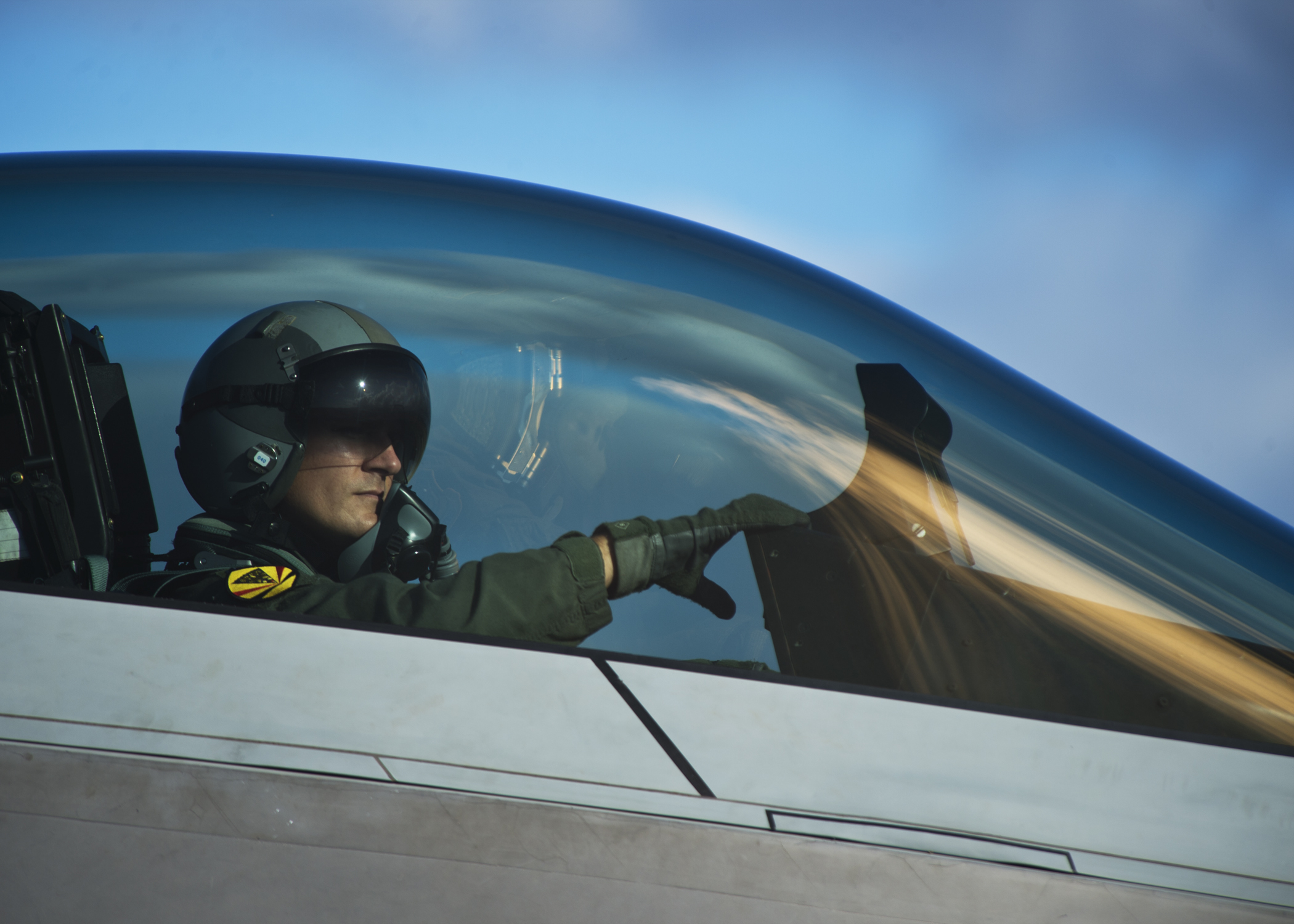 A pilot from the Hawaiian Raptors awaits the conclusion of an end of runway inspection of the F-22 Raptor on Joint Base Pearl Harbor-Hickam, Hawaii, April 20, 2015. The F-22 possesses a sophisticated sensor suite allowing the pilot to track, identify, shoot and kill air-to-air threats before being detected. Significant advances in cockpit design and sensor fusion improve the pilot's situational awareness. (U.S. Air Force photo by Tech. Sgt. Aaron Oelrich/Released)