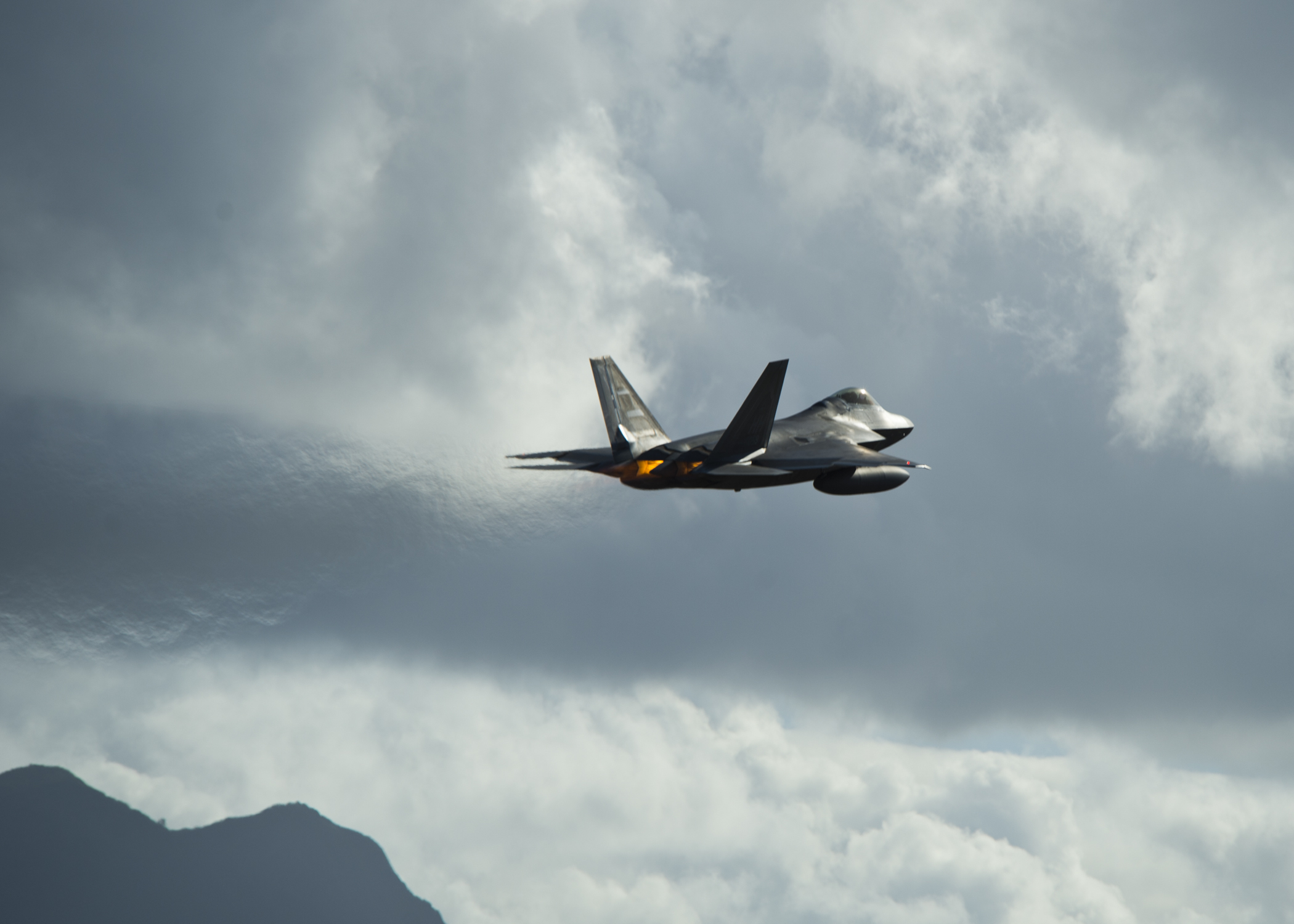 A United States Air Force F-22 Raptor, from the Hawaiian Raptors, takes off from Joint Base Pearl Harbor-Hickam, Hawaii, April 20, 2015. The F-22 Raptor has a range of 1,600 nautical miles with the two external wing fuel tanks attached. (U.S. Air Force photo by Tech. Sgt. Aaron Oelrich/Released)