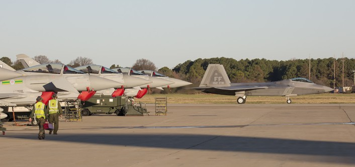 USAF F-22 Raptor taxis past line up RAF Typhoons at the inaugural TriLateral exercise JBLE.