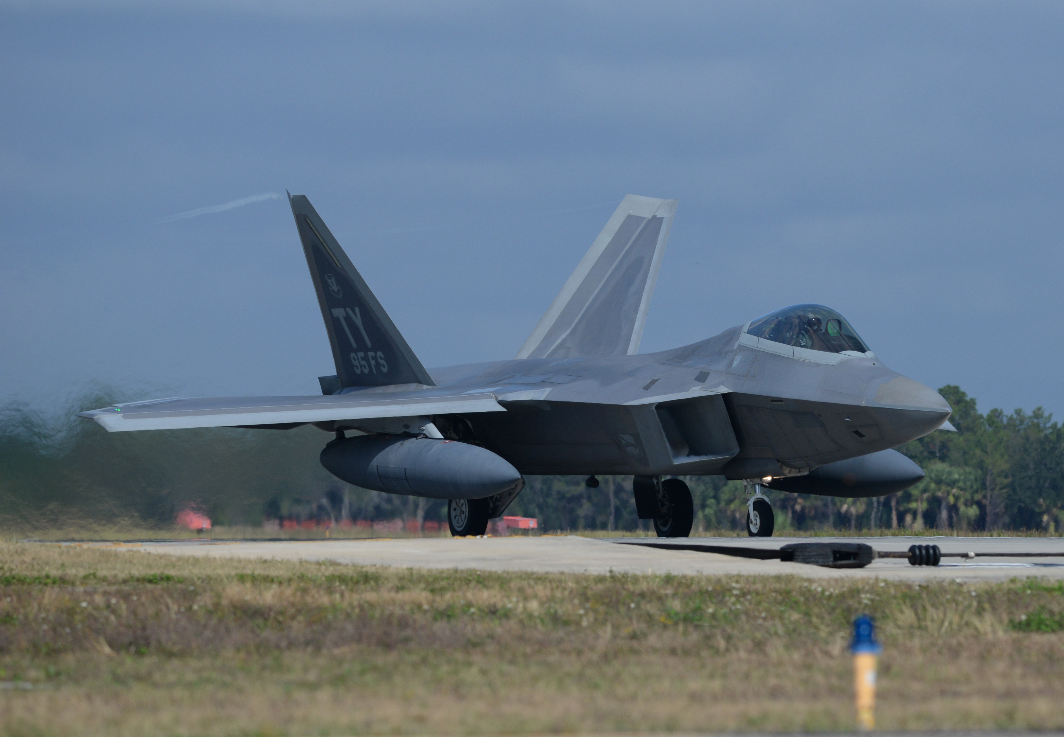 An F-22 Raptor from Tyndall Air Force Base, Fla., commences take off Nov. 5 at the Tyndall flightline. The F-22 Raptor's combination of stealth, supercruise, maneuverability and integrated avionics, coupled with improved supportability, represents an exponential leap in warfighting capabilities and allows for the full realization of operational concepts that are vital to the 21st century Air Force. (U.S. Air Force photo by Senior Airman Sergio A. Gamboa/Released)