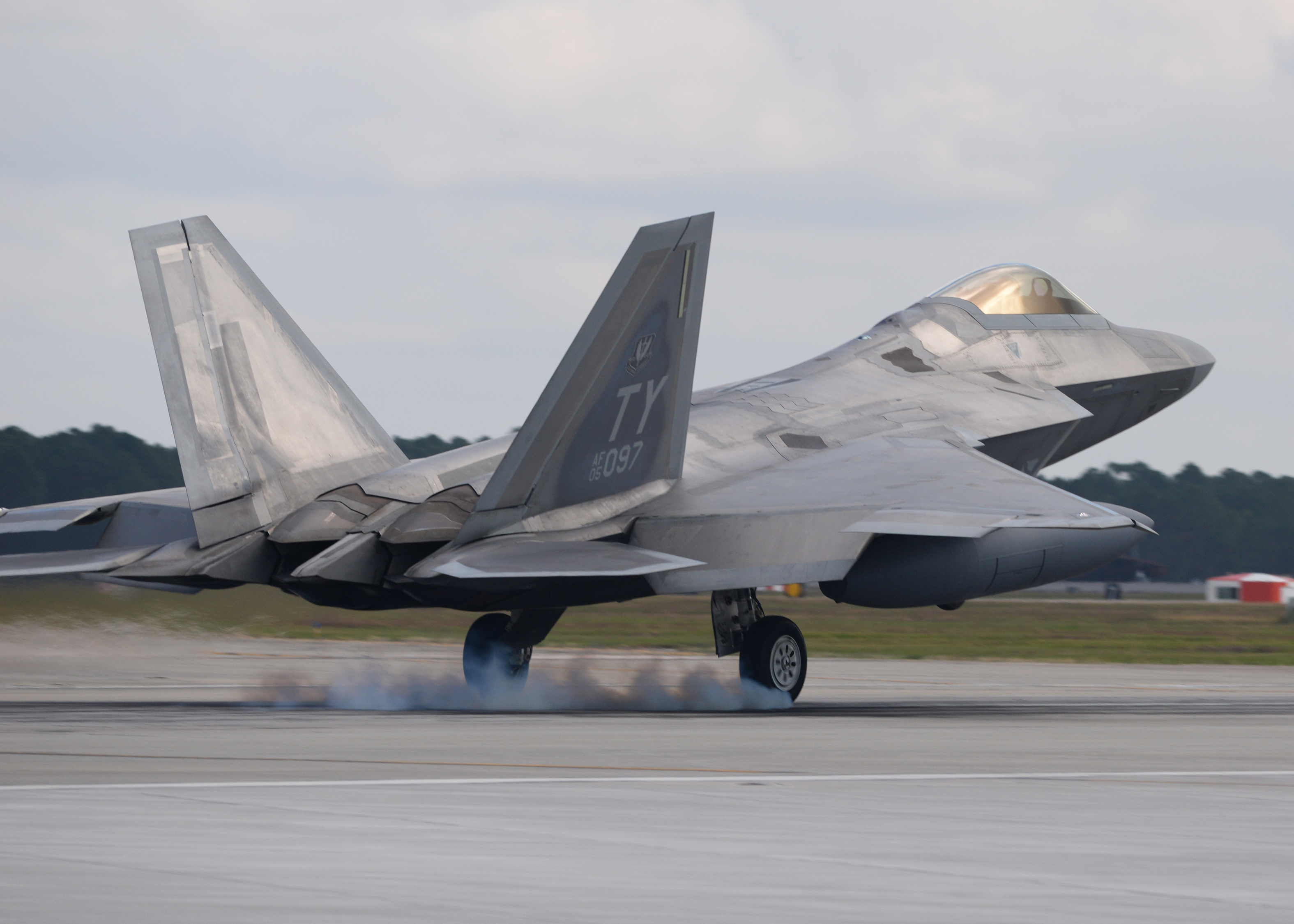 An F-22 Raptor from Tyndall Air Force Base, Fla., touches down Nov. 5 at the Tyndall flightline. The F-22 Raptor's combination of stealth, supercruise, maneuverability and integrated avionics, coupled with improved supportability, represents an exponential leap in warfighting capabilities and allows for the full realization of operational concepts that are vital to the 21st century Air Force. (U.S. Air Force photo by Senior Airman Sergio A. Gamboa/Released)