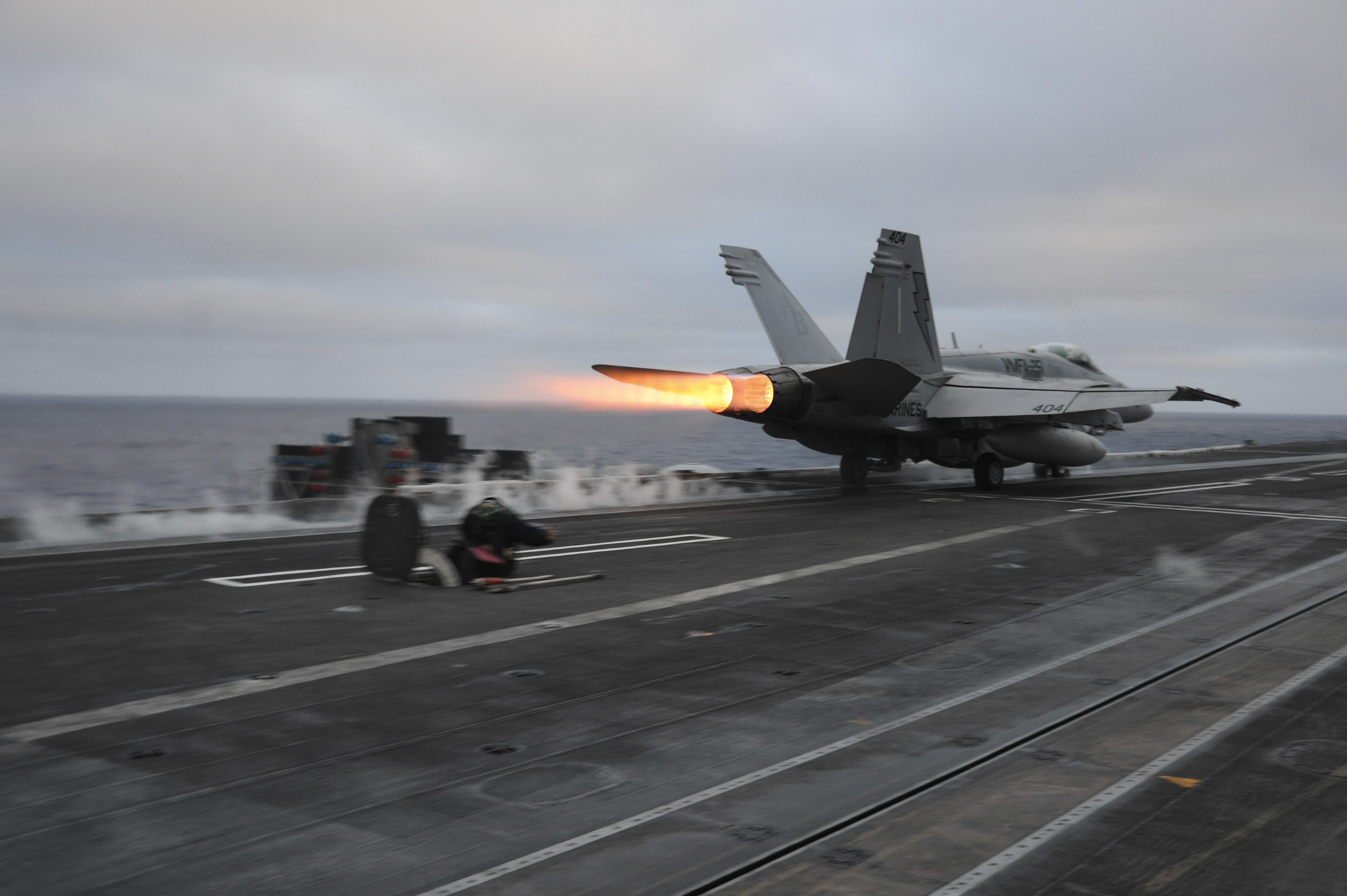 151121-N-NV908-015 PACIFIC OCEAN (Nov. 21, 2015) – An F/A-18C Hornet, assigned to the Thunderbolts of Marine Strike Fighter Squadron (VMFA) 251, launches off the flight deck of the aircraft carrier USS Theodore Roosevelt (CVN 71). The Thunderbolts, along with all Carrier Air Wing One aircraft, are on their way home after completing an eight-month deployment as part of the Theodore Roosevelt Carrier Strike Group.  Theodore Roosevelt is operating in the U.S. 3rd Fleet area of operations as part of a worldwide deployment en route to its new homeport in San Diego to complete a three-carrier homeport shift. (U.S. Navy Photo by Mass Communication Specialist Seaman Chad M. Trudeau/Released)