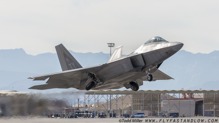 "F-22A Raptor from the 95 FS ""Boneheads"" of Tyndall AFB launches on Red Flag 16-1 sortie."