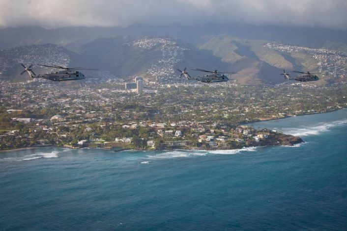 U.S. Marine CH-53E Super Stallion helicopters assigned to Marine Heavy Helicopter Squadron 463, fly in formation off the coast of Oahu, Hawaii, April 29th, 2016, after interoperability operations with the 25th Infantry Division's 25th Combat Aviation Brigade.  (U.S. Marine Corps photo by Capt. Tim Irish)