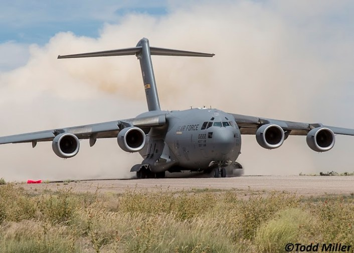 "Air Mobility Command C-17A of the 437 AW/315 AW, Charleston, SC ""cleans"" the runway during take off from Keno Airfield on the NTTR during Joint Forcible Entry Exercise (June 2016)."