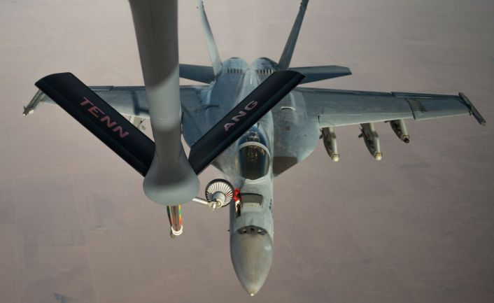 A U.S. Navy F/A-18 Super Hornet receives fuel from a KC-135 Stratotanker over Iraq in support of Operation Inherent Resolve Oct 17, 2016. The KC-135 provides the core aerial refueling capability for the U.S. Air Force and has excelled in this role for more than 50 years. (U.S. Air Force photo by Staff Sgt. Douglas Ellis/Released)