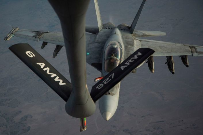 A U.S. Navy F/A-18 Super Hornet approaches a KC-135 Stratotanker refueling drogue over Iraq Sept. 28, 2016. Airmen from the 340th Expeditionary Air Refueling Squadron refueled U.S. Navy F/A-18 Super Hornets over Iraq in support of Combined Joint Task Force-Operation Inherent Resolve. The U.S. and more than 60 coalition partners work together to eliminate Daesh and the threat they pose to Iraq and Syria. (U.S. Air Force photo/Tech. Sgt. Larry E. Reid Jr., Released)