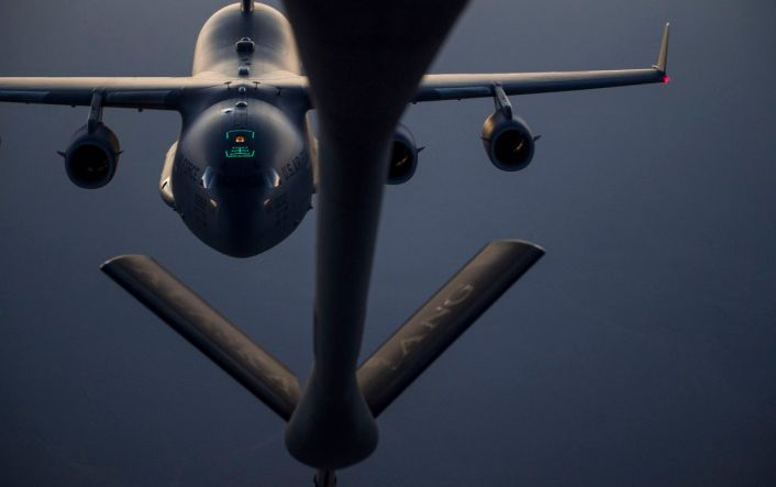 A C-17 Globemaster III approaches a KC-135 Stratotanker before performing a refueling mission over Iraq in support of Operation Inherent Resolve September 15, 2016. The KC-135 provides the core aerial refueling capability for the U.S. Air Force and has excelled in this role for more than 50 years. (U.S. Air Force photo by Staff Sgt. Douglas Ellis/Released)