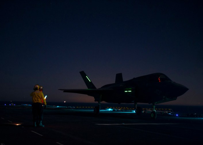 161113-N-VR008-0097 PACIFIC OCEAN (Nov. 13, 2016) Sailors assigned to amphibious assault ship USS America (LHA 6) prepare to launch an F-35B Lightning II aircraft from the flight deck during flight operations. The F-35B short takeoff/vertical landing (STOVL) variant is the world's first supersonic STOVL stealth aircraft. America, with Marine Operational Test and Evaluation Squadron 1 (VMX-1), Marine Fighter Attack Squadron 211 (VMFA-211) and Air Test and Evaluation Squadron 23 (VX-23) embarked, are underway conducting operational testing and the third phase of developmental testing for the F-35B Lightning II aircraft, respectively. The tests will evaluate the full spectrum of joint strike fighter measures of suitability and effectiveness in an at-sea environment. (U.S. Navy photo by Petty Officer 3rd Class Kyle Goldberg/Released)