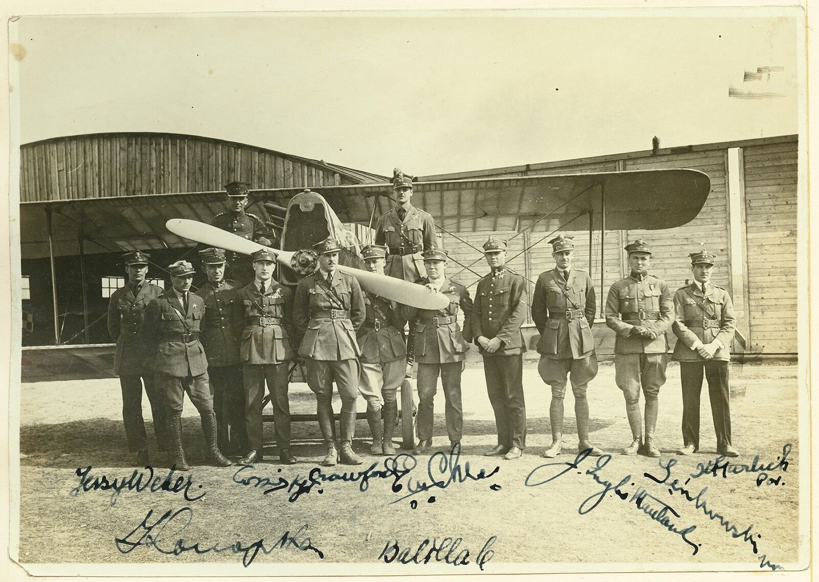 Original members of the Kosciuszko Squadron, Chess is the man whose face is partly hidden by the plane's propeller