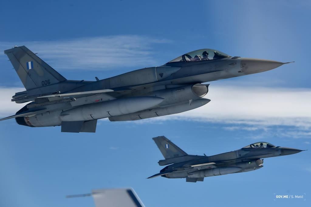 Two HAF F-16s close on the LJ45 left wing. Image credit