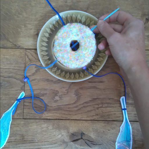 threading ribon thhough your doughnut dreamcatcher party decoration