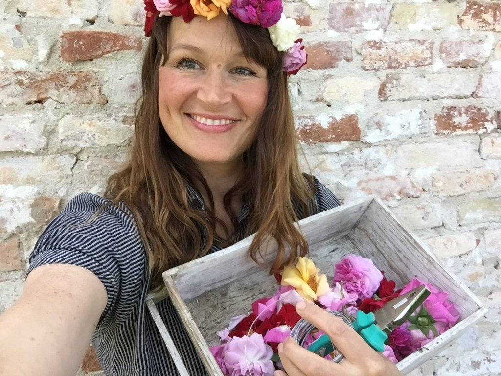 ulla lake holding a basket of flowers and some garden shears
